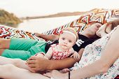 Happy Stylish Family Playing With Cute Daughter And Cuddling, Relaxing In Hammock On Summer Vacation poster