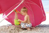 Young Boy Playing In Sand