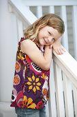 Cute Girl Leaning On Railing