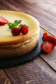 Homemade Cheesecake With Fresh Strawberries And Mint For Dessert poster