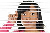 Woman Looking Through Jalousien