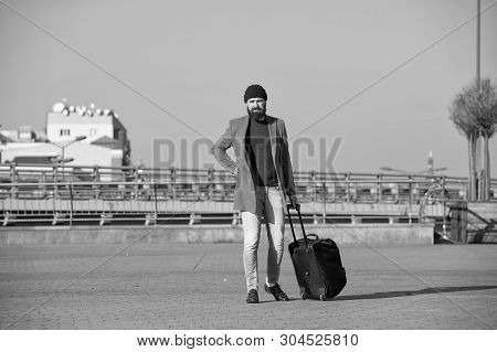 poster of Moving To New City Alone. Hipster Ready Enjoy Travel. Carry Travel Bag. Man Bearded Hipster Travel W