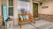 Panorama Frame Wooden Porch Bench With Pillows Against The Shiny Front Window poster