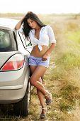 Sexy hot woman near car outdoor