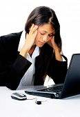 businesswoman working at her desk with laptop computer is stressed, frustrated and overwhelmed by de