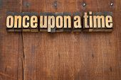 once upon a time opening phrase - storytelling concept - vintage letterpress wood type text against