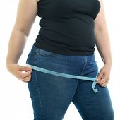 Overweight unhappy young woman measuring her hips, isolated over white background. Overeating xxl si poster