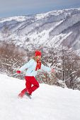 Woman Running Through Snow
