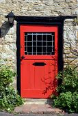 foto of front door  - An old red door to the front of an English country cottage - JPG