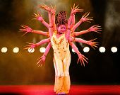 SHANGHAI, CHINA - NOVEMBER 28: A team of dancers from the world famous Shanghai acrobats perform the rhythmic hands of Buddha dance for tourist on stage on November 28, 2011 in Shanghai, China.