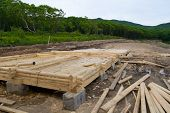 stock photo of trussle  - Construction of a new camping on coast of a sea bay - JPG