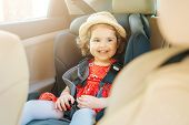 Cute Little Baby Child Sitting In Car Seat. Portrait Of Cute Little Baby Child Sitting In Car Seat.s poster