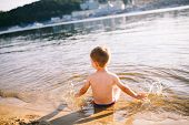 Theme Is Summer Time And Rest Near The Water. Little Joyful Caucasian Funny Boy Plays And Enjoys In  poster