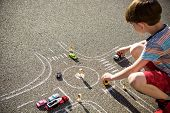 Funny Kid Boy Having Fun With Picture Drawing Traffic Car With Chalks. Creative Leisure For Children poster