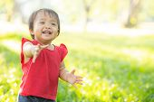 Portrait Face Of Cute Asian Little Girl And Child Happiness And Fun In The Park In The Summer, Smile poster
