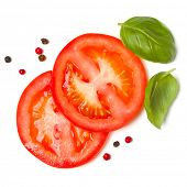 Slices of tomato and basil leaves isolated on white background. Top view, flat lay. poster