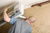 picture of air conditioner  - Air conditioning master installs a new air conditioner in the apartment - JPG