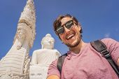 Man Tourist On Background Of Big Buddha Statue Was Built On A High Hilltop Of Phuket Thailand Can Be poster