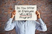 Employee Benefits Concept With Young Businessman Asking do You Offer An Employee Wellness Program? poster