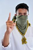 Young Handsome Asian Muslim Man Wearing Serban Or The Keffiyeh, Face Cover And Show One Fingger A Si poster