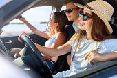 Friends Rented A Car For Summer Road Trip To The Beach. Female Driver In Glasses And Straw Hat Havin poster