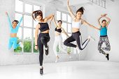 A Group Of Girls Jumping To Dance In The Dance Class. The Concept Of Sports, A Healthy Lifestyle, Fi poster