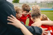 Group Of Happy Boys Making Sports Huddle. Smiling Kids Standing Together With Coach On Grass Sports  poster