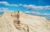 Industrial Sand Quarry. Sand Pit. Construction Industry. Sand Hill Agains The Blue Sky. poster