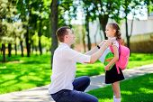 Father Leads Daughter To School In First Grade. First Day At School. Back To School. poster