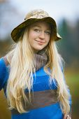 pic of fisherwomen  - beautiful girl with long blond hair fishing - JPG
