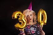 Young Attractive Blonde Woman Celebrates Her 30th Birthday. Beautiful Cheerful Blonde With Golden Ba poster