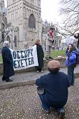 Occupy Exeter celebrate their achievements as they leave their camp on Exeter Cathedral Green
