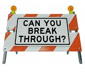 A road barrier roadblock reading Can You Break Through asking if you can summon the courage and ener
