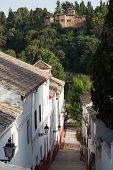 Street In Old Town Of Granada Spain With Alhambra