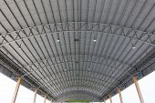 Steel Roof Structure. Moonlight Bulb. Steel Roof Structure With Roof Tiles. Architectural Structure  poster
