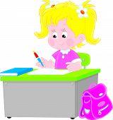 Schoolgirl writing a test in school