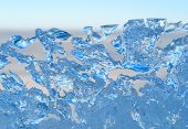 stock photo of growler  - melting ice on coastline in early spring - JPG