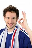 portrait of young footballplayer making okay sign