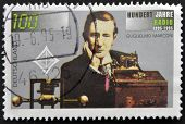 stamp printed in Germany shows Guglielmo Marconi and Transmitting Equipment Centenary of Radio