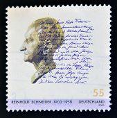 A stamp printed in Germany shows Reinhold Schneider