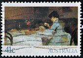 stamp printed in Australia shows Petit Dejeu ner by Frederick McCubbin