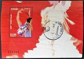A stamp printed in Spain dedicated to balls and folk dances shows woman dancing Sevillanas