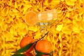 Yellow fruit juice ice in vase on decorative yellow background