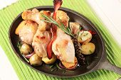 spiced chicken with potatoes, in the iron pan