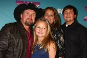 LOS ANGELES - DEC 20:  Tate Stevens - Winner of 2012 X Factor, with his family at the 'X Factor' Sea