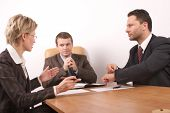 stock photo of business meetings  - business meeting of 3 persons in the office - JPG