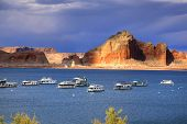 Many boats are anchored in lake powell