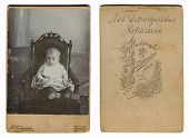 RUSSIAN EMPIRE - CIRCA 1880: Vintage photo of a child (Lev Dmitrievich Dragoli), and its downside, c