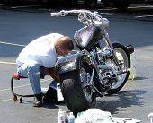 Man Cleaning Bike