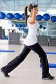 picture of workout-women  - gym woman doing aerobics and lifting weights - JPG